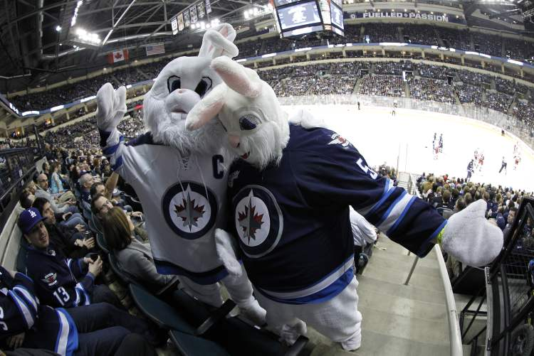 Cloudy Cuddles McRabbit and Theodore L. Rabbit cheer as the Jets face the Carolina Hurricanes on Easter weekend.