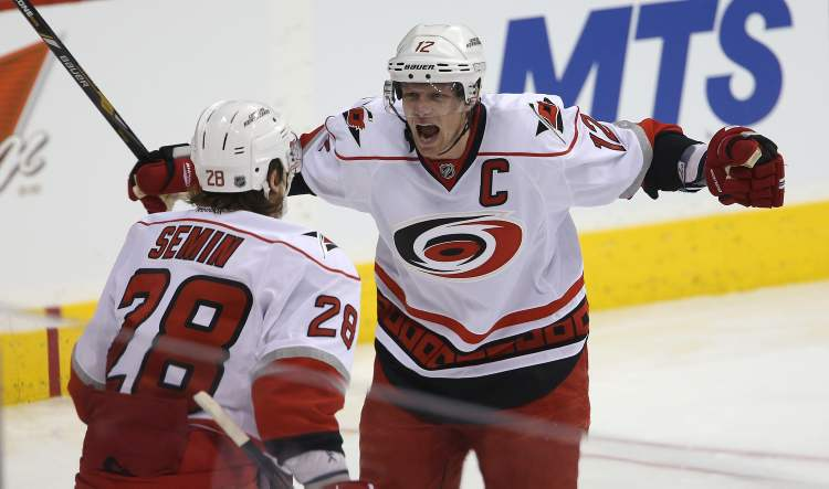 Carolina Hurricanes' Alexander Semin celebrates with team captain Eric Staal after the pair combined on a goal by Semin early in the first period.