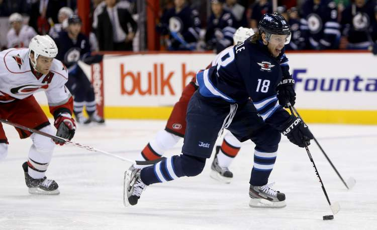 Winnipeg Jets' Bryan Little (18) skates towards the Carolina Hurricanes net on a breakaway during second-period action.