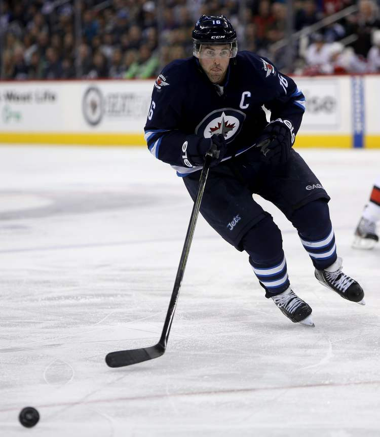 Winnipeg Jets captain Andrew Ladd rushes to the puck during second period action.