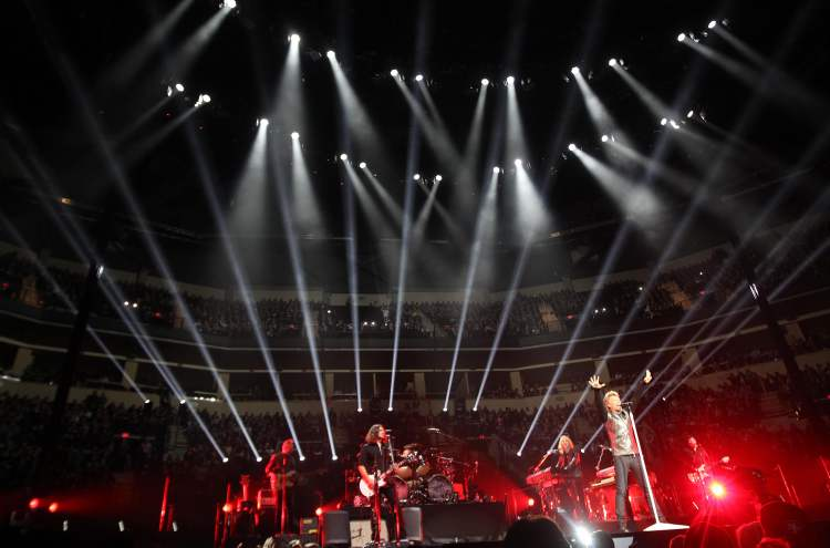 Lights shoot out into the crowd at Friday night's Bon Jovi concert at the MTS Centre. (JOE BRYKSA / WINNIPEG FREE PRESS)