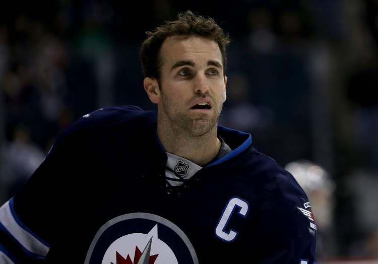 Winnipeg Jets' Andrew Ladd (16) during warmup as the Jets prepare to face the Philadelphia Flyers at MTS Centre in Winnipeg, Saturday. (TREVOR HAGAN / WINNIPEG FREE PRESS)