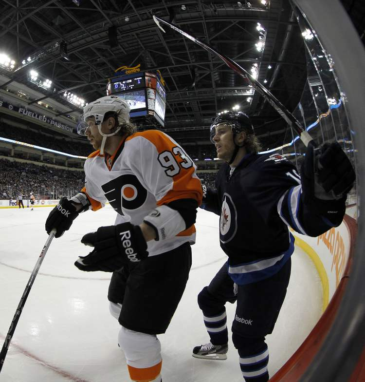 Philadelphia Flyers Jakub Voracek (93) battles with Winnipeg Jets' Bryan Little (18) during the first period of NHL action at MTS Centre in Winnipeg, Saturday. (TREVOR HAGAN / WINNIPEG FREE PRESS)