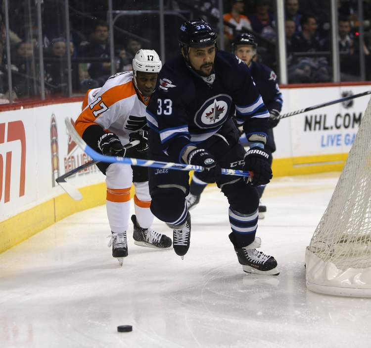 Winnipeg Jets' Dustin Byfuglien (33) is chased by Philadelphia Flyers' Wayne Simmonds (17) during the first period at the MTS Centre Saturday. (TREVOR HAGAN / WINNIPEG FREE PRESS)