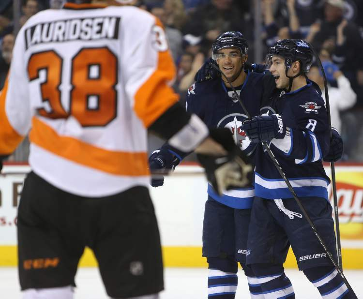 Winnipeg Jets' Evander Kane (9) and Alexander Burmistrov (8) celebrate after Kane scored during the second period of Saturday afternoon's game against the Philadelphia Flyers. (TREVOR HAGAN / WINNIPEG FREE PRESS)