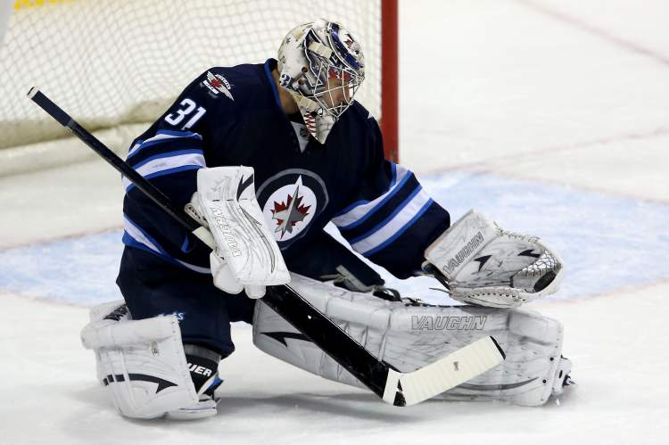 Winnipeg Jets' goaltender Ondrej Pavelec (31) makes a glove save against the New York Islanders' during first period NHL action at MTS Centre in Winnipeg, April 20. Pavelec's ability has helped get the Jets to where they are, but he needs to be even better.