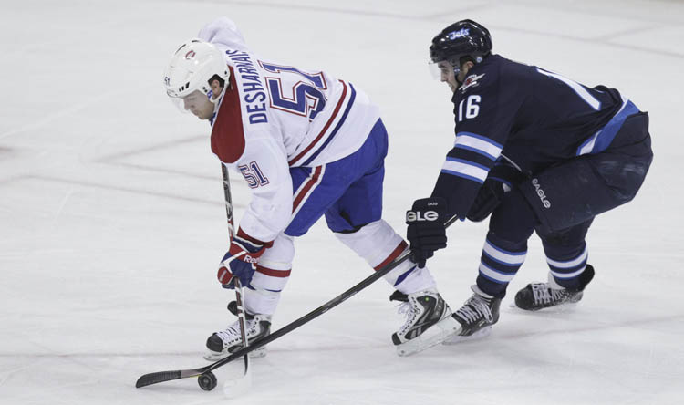 Winnipeg Jets' Andrew Ladd tries to stick check Montreal Canadiens' David Desharnais (51) but was called for a penalty Thursday night. (MIKE DEAL / WINNIPEG FREE PRESS)