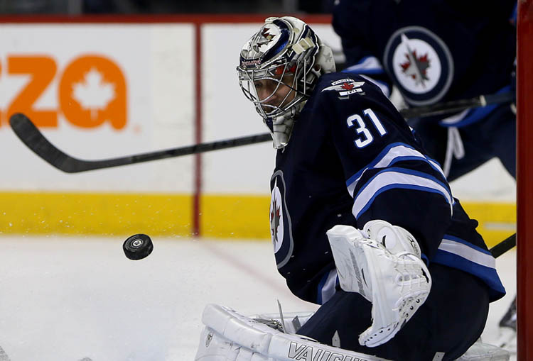 Winnipeg Jets' Ondrej Pavelec stops a Montreal Canadiens' shot during the first period.