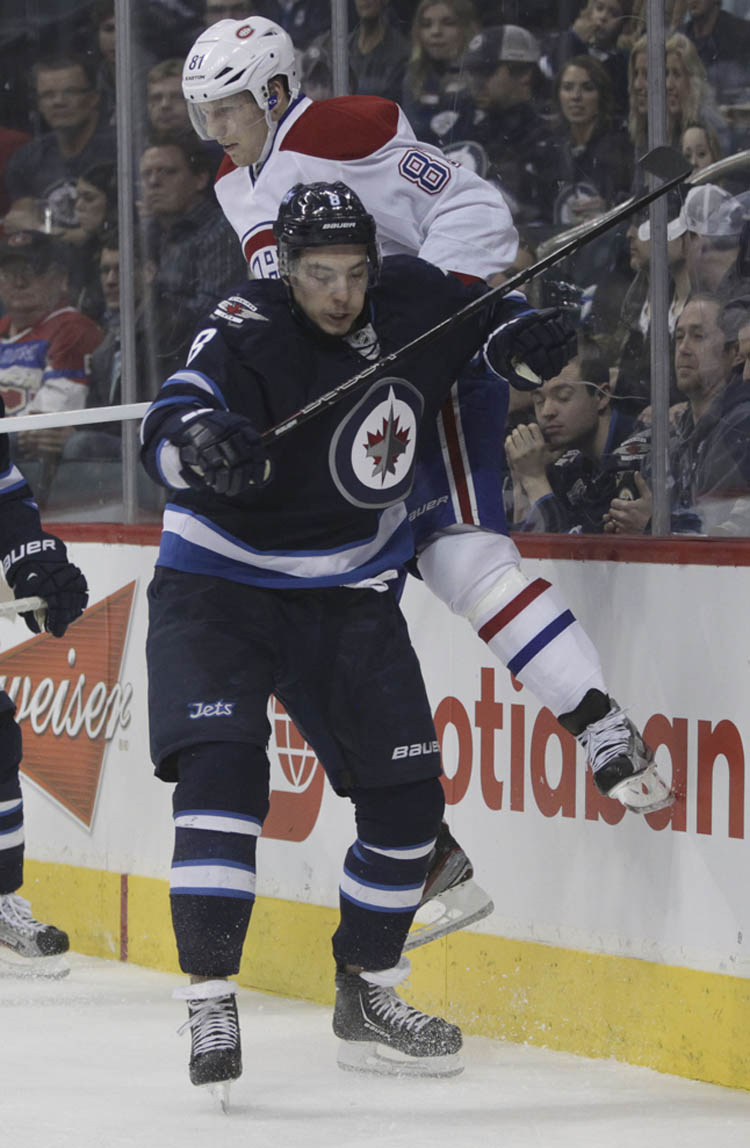 Winnipeg Jets' Alexander Burmistrov (8) checks Montreal Canadiens' Lars Eller (81) behind the Montreal Canadiens' net in the second period. (MIKE DEAL / WINNIPEG FREE PRESS)
