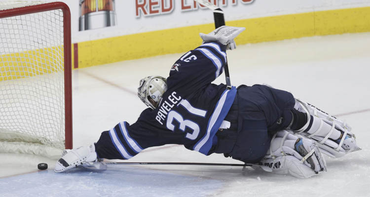 Winnipeg Jets' goaltender Ondrej Pavelec can't reach the puck to stop Tomas Plekanec's game-tying goal to make it 2-2 in the third period. (MIKE DEAL / WINNIPEG FREE PRESS)