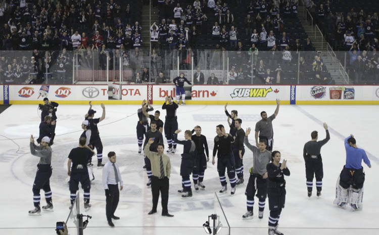 The Winnipeg Jets take to the ice one final time at the end of the final regular season game to salute the fans after losing to the Montreal Canadiens' 4-2. (MIKE DEAL / WINNIPEG FREE PRESS)