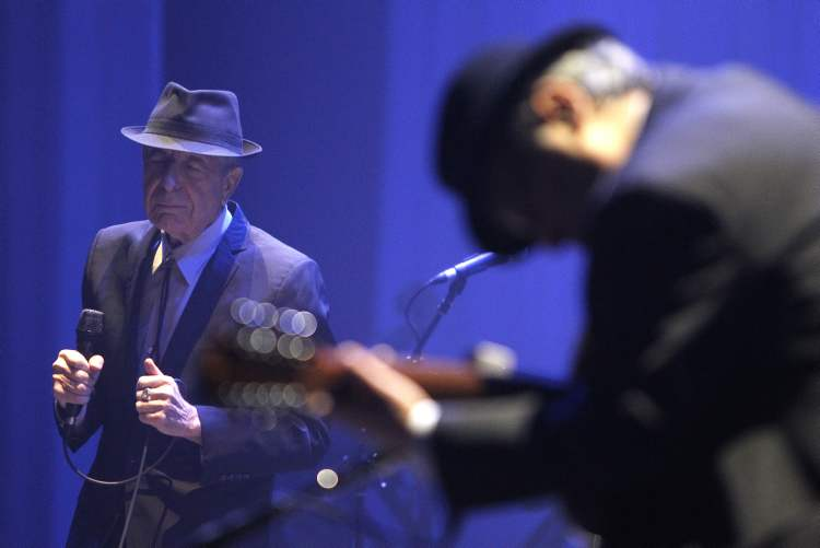 Leonard Cohen and his guitarist Friday at the MTS Centre.