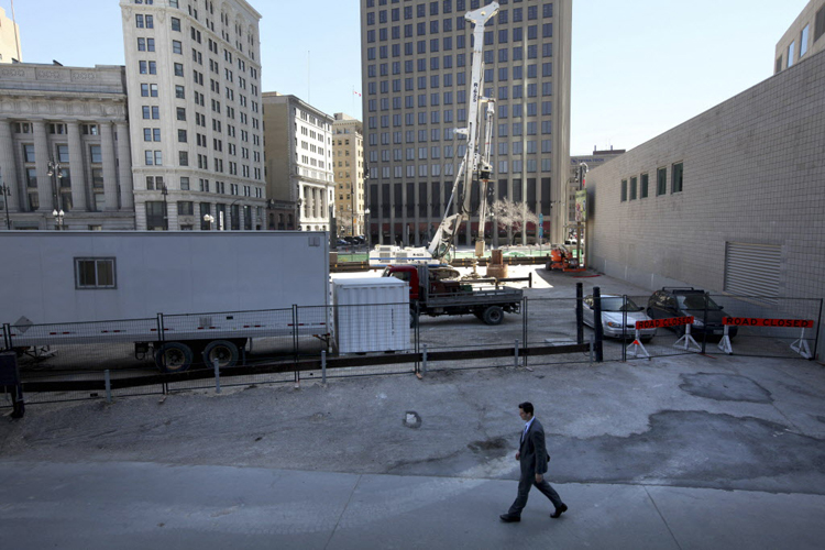 PCL workers begin drilling piles last month for what is believed to be a highrise hoteljust north of  201 Portage Avenue.