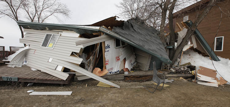 Some houses were nearly completely demolished by the wall of ice. (John Woods / Winnipeg Free Press)