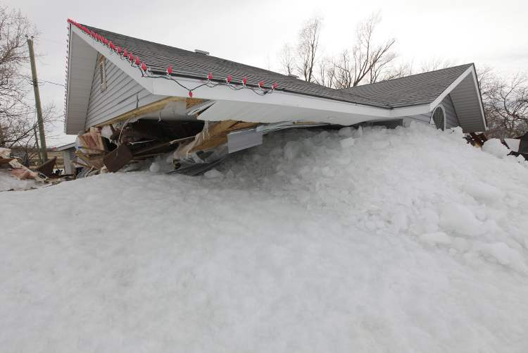 Ice encases a property Sunday at Ochre Beach, caused when lake ice was blown ashore by strong winds Friday night.