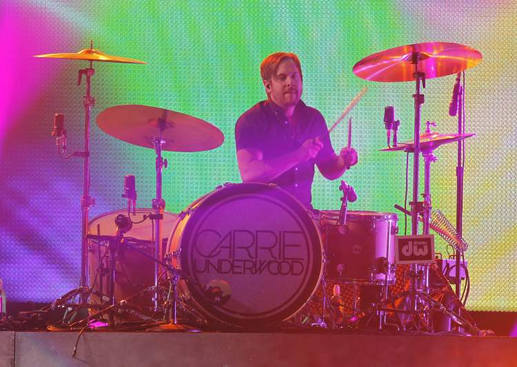 Carrie Underwood's drummer is bathed in light. (BORIS MINKEVICH / WINNIPEG FREE PRESS)