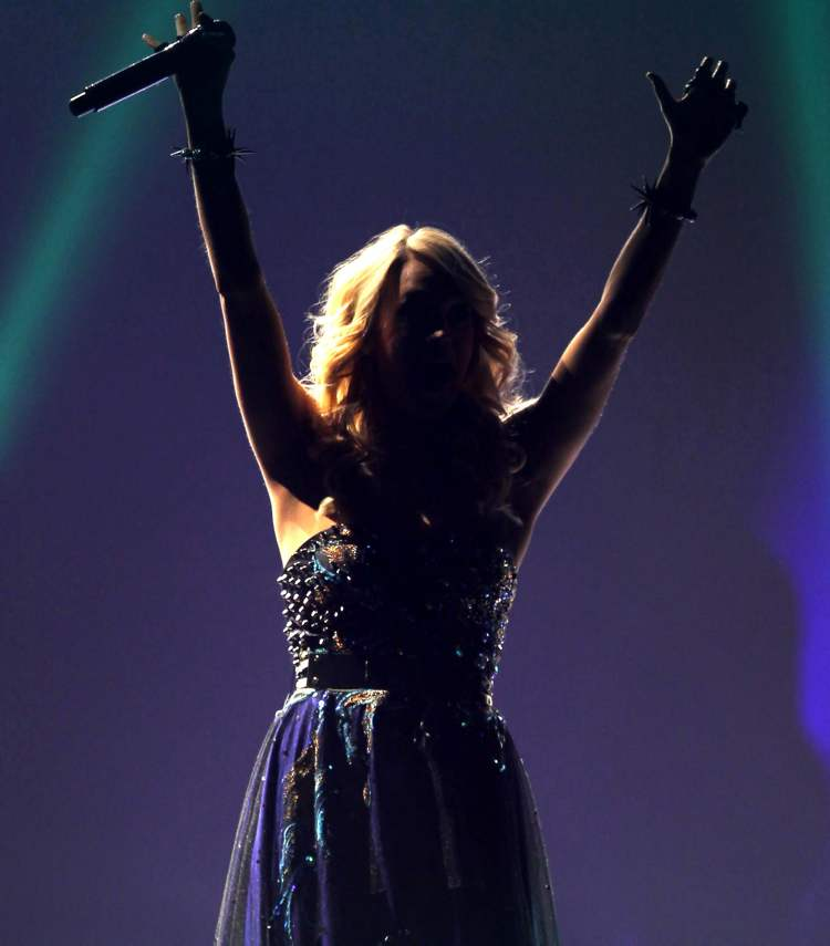 Carrie Underwood waves to the sold-out MTS Centre.