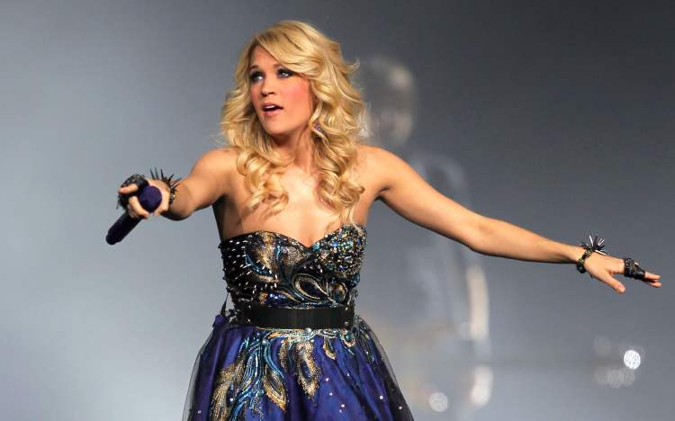 Carrie Underwood listens to the crowd.