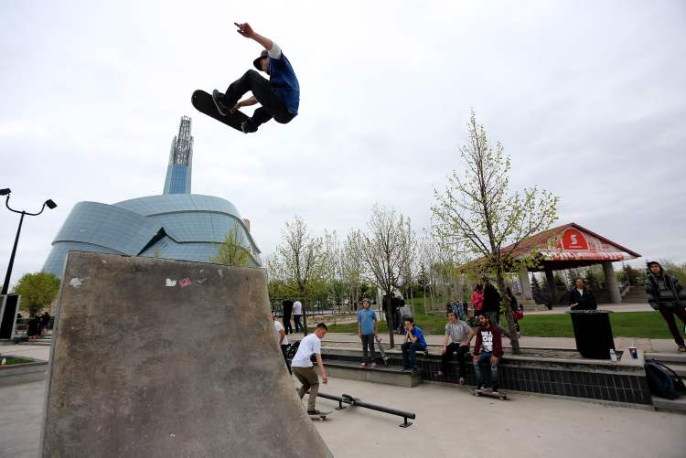 Kevin Delorme, 23, catches some air at the skatepark at The Forks during the Skate4Cancer event Saturday.