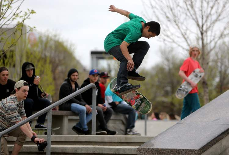 A participant in the Skate4Cancer skateboarding competition performs a trick.