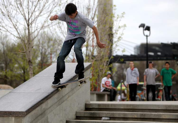 A participant grinds down stairs during the Skate4Cancer skateboarding competition Saturday. (TREVOR HAGAN / WINNIPEG FREE PRESS)