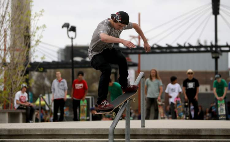 A participant performs a rail slide during the Skate4Cancer skateboarding competition Saturday. (TREVOR HAGAN / WINNIPEG FREE PRESS)