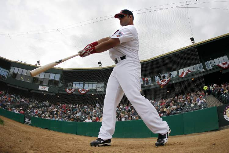 Tim Smith (9) of the Winnipeg Goldeyes warms up. (John Woods / Winnipeg Free Press)