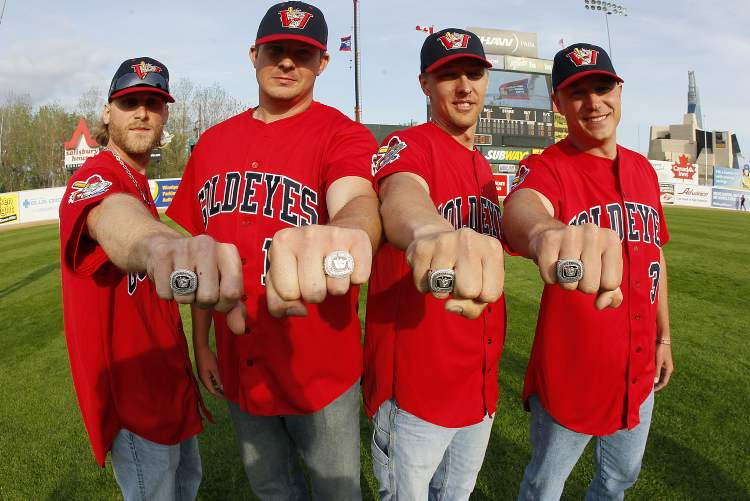Chris Salamida, Zach Baldwin, Brian Beuning and Ace Walker show off their championship rings.