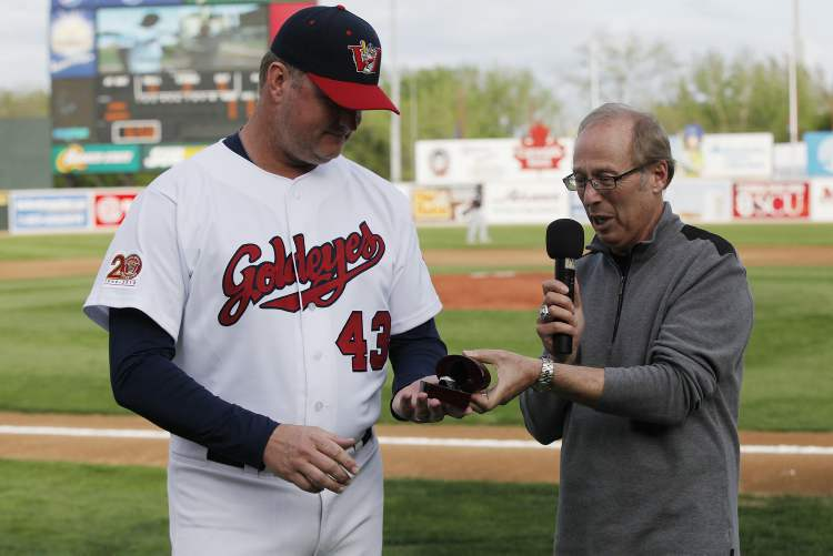 Mayor Sam Katz presents a championship ring to manager Winnipeg Goldeyes manager Rick Forney.