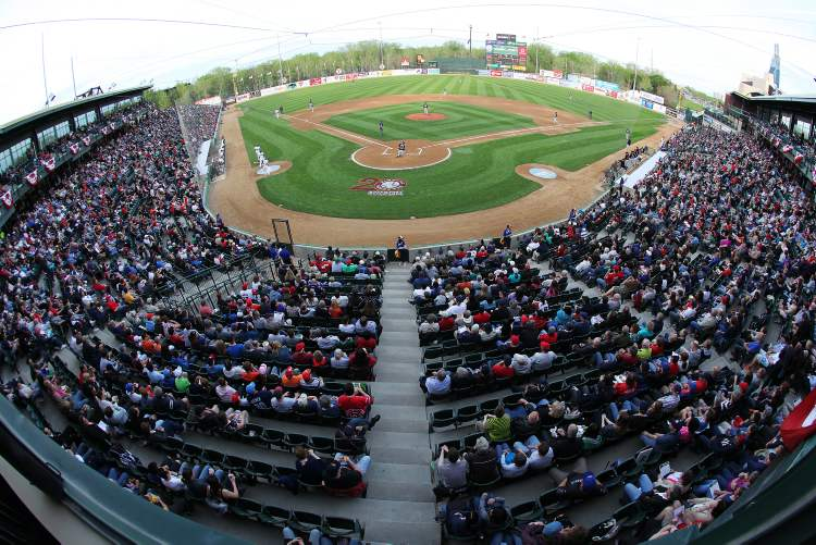 A crowd of 7,886 — a sell-out — gathers at Shaw Park for the Winnipeg Goldeyes' home opener.