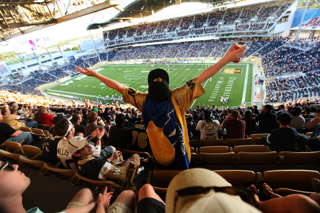 Winnipeg Blue Bomber fans Kurtis Perkins celebrate a  Bomber field goal in the second half of the game against Toronto at Investors Group Field Wednesday evening.