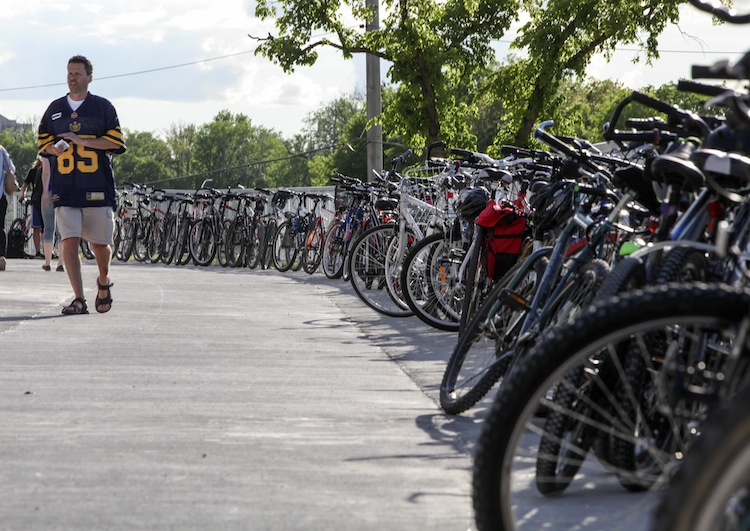 The game hadn't even begun and bike valet volunteers estimated that over 600 bikes were parked in and around the stadium grounds by fans attending the game. About 200 of those were parked in the bike valet area at the front of the stadium. (Jessica Burtnick / Winnipeg Free Press)