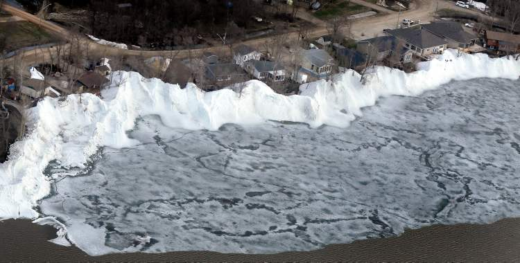 Ice on Dauphin Lake in the community of Ochre Beach threatens to blow back onshore and do further damage to homes and cottages Monday.
