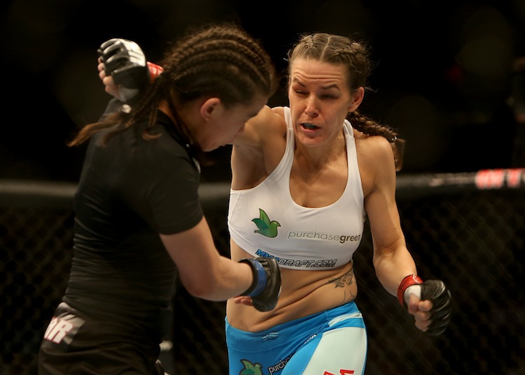 Alex Davis, right, fires a right hand at Rosi Sexton during their bantamweight bout.