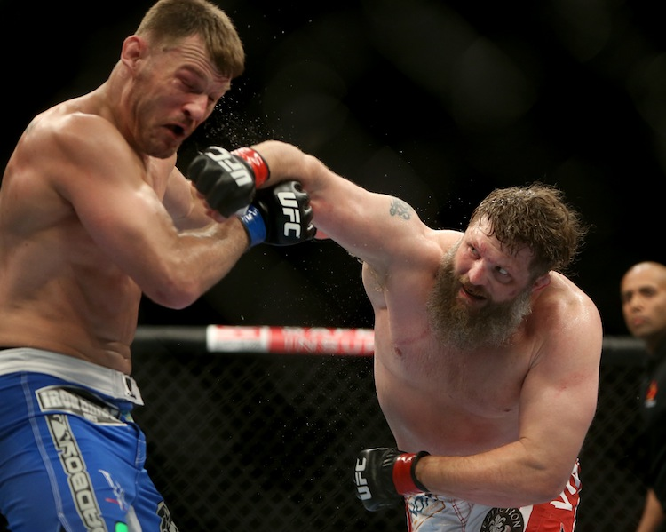 Roy Nelson (right) lands a heavy right on Stipe Miocic during their heavyweight bout. (TREVOR HAGAN / WINNIPEG FREE PRESS)