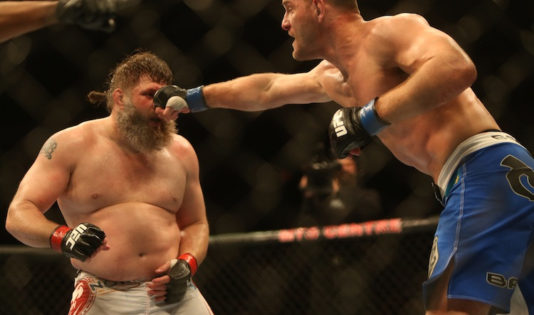 Stipe Miocic (right) hits Roy Nelson during their heavyweight bout.
