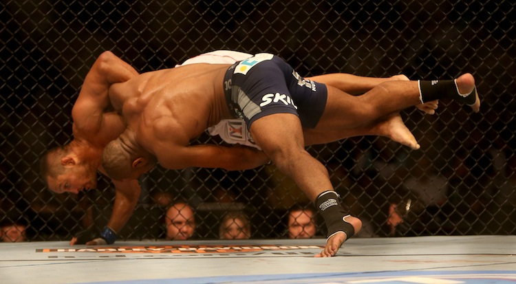 Rashad Evans drives Dan Henderson to the mat.