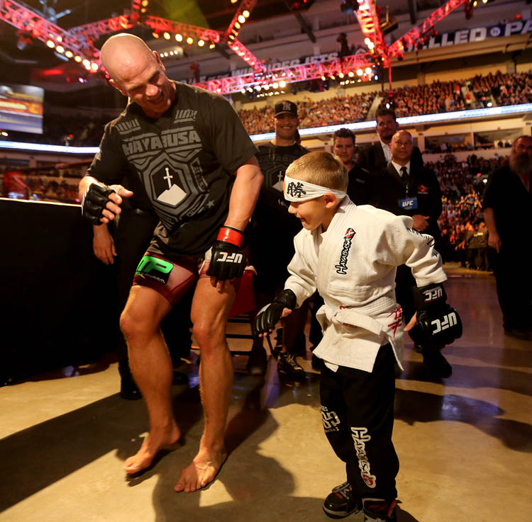 Ryan Jimmo does the robot with Avery Kelleher, 6, following Jimmo's victory over Igor Pokrajac. (Trevor Hagan / Winnipeg Free Press)