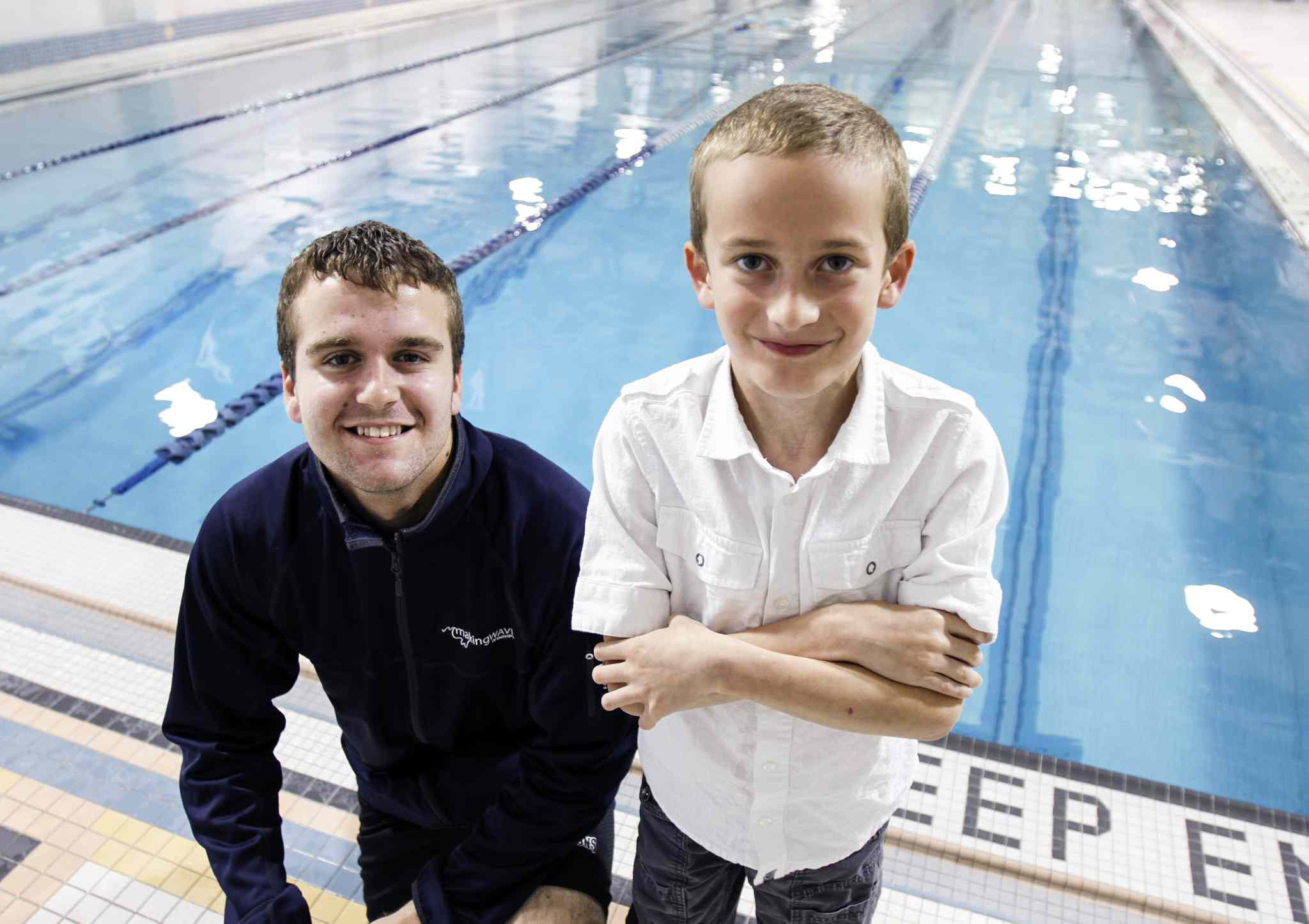 Cameron Krisko (left), runs Making Waves, a program at Seven Oaks Pool that teaches special-needs kids like Josh Bangert, who has muscular dystrophy, how to swim.