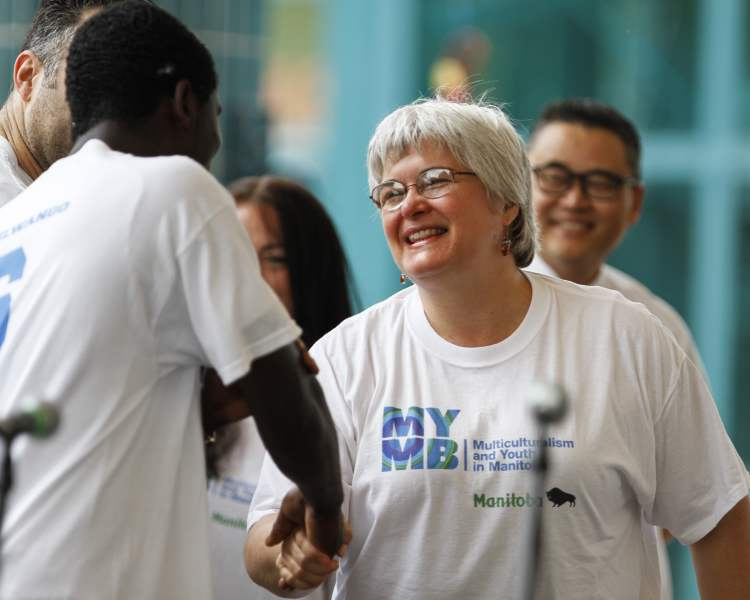 Immigration and Multiculturalism Minister Christine Melnick congratulates members of the MYMB (My Manitoba) youth program Saturday at The Forks as part of Multicultural Day.  JESSICA BURTNICK / WINNIPEG FREE PRESS