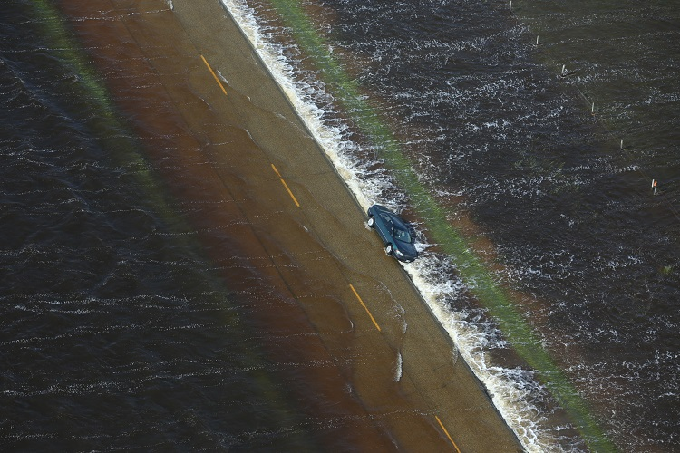A vehicle is seen washed off of Highway 83 southeast of Reston. (Tim Smith / Brandon Sun)