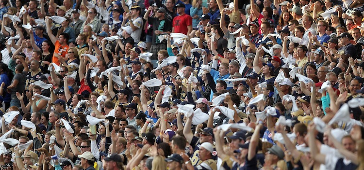 A packed house waves towels at Investors Group Field. (Phil Hossack / Winnipeg Free Press)