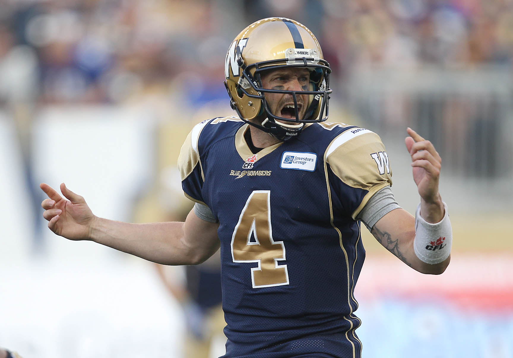 Winnipeg Bombers quarterback Buck Pierce yells instructions to teammates during the first quarter.