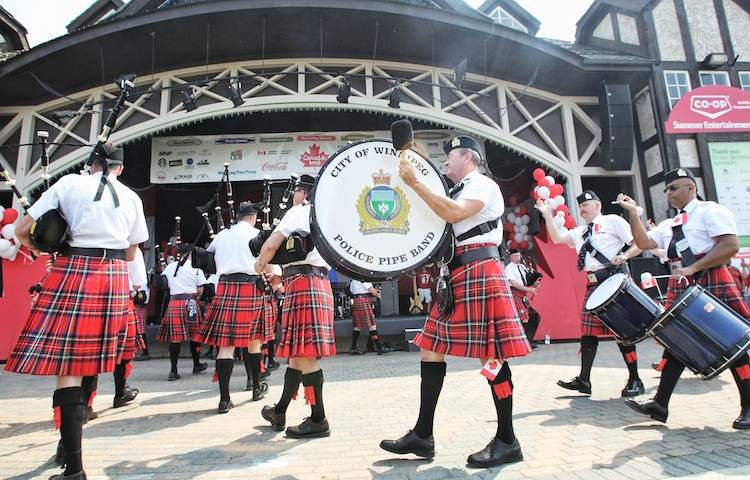 The City of Winnipeg Police Pipe Band march in front of the Lyric Theatre in Assiniboine Park Monday. (Mike Deal / Winnipeg Free Press)