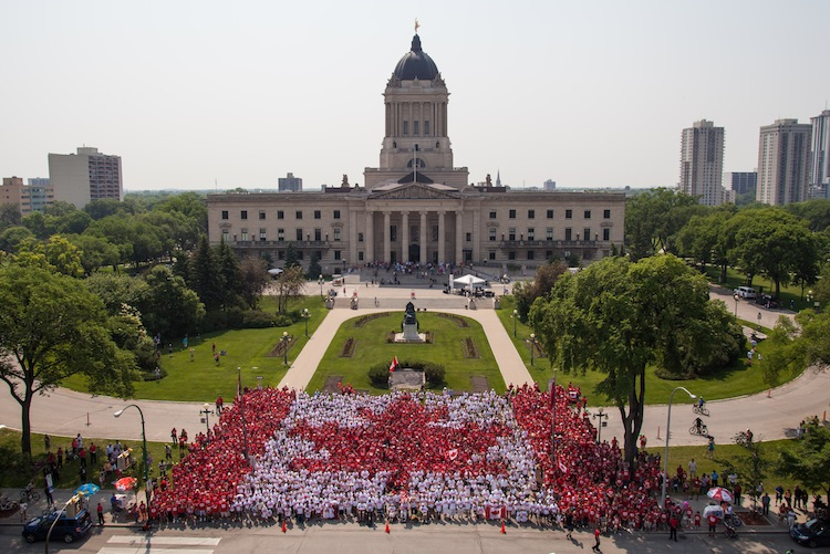 Organizers estimated around 3,500 people turned out to help create Winnipeg's Living Flag. (Ron Gilfillan / Handout)