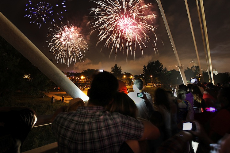 Thousands cap off a hot, activity-filled Canada Day with fireworks. (John Woods / Winnipeg Free Press)