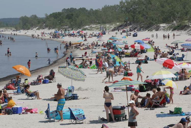 Many People Came To Cool Off At Grand Beach Wednesday Afternoon As Temperatures Soared Above 30