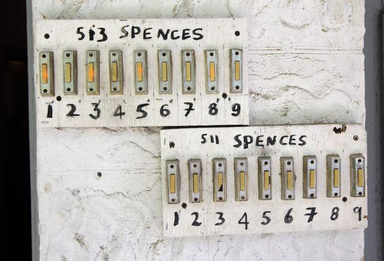 This Spence Street rooming house has 18 suites and accompanying doorbells.