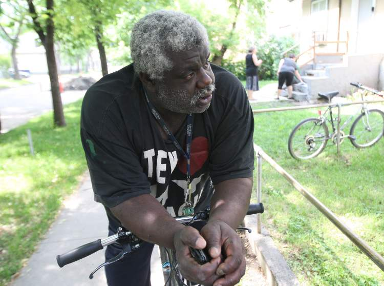 Albert, caretaker at a Furby Street rooming house, is very passionate about his neighborhood. (JOE BRYKSA / WINNIPEG FREE PRESS)