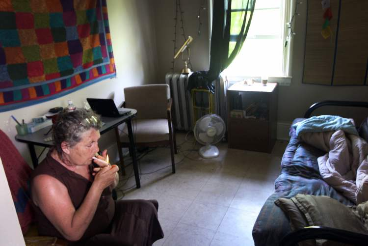 Cathy inside her third-floor suite in a Furby Street rooming house.   (JOE BRYKSA / WINNIPEG FREE PRESS)